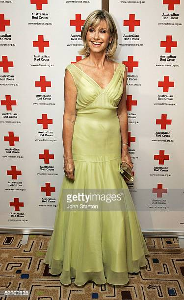 Actress Olivia NewtonJohn poses for photos as she arrive at the 90th anniversary gala dinner for the Australian Red Cross on March 2 2005 in Sydney...