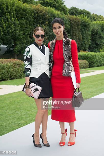Actress Olivia Palermo wearing Dior with Editor in Chief of Tank Magazine Caroline Issa who is wearing an Emilia Wickstead waistcoat and dress with...