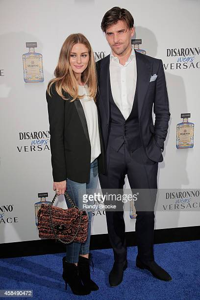 Actress Olivia Palermo with Model Johannes Huebl attend the Disaronno Wears Versace launch event at Root Drive In on November 5 2014 in New York City