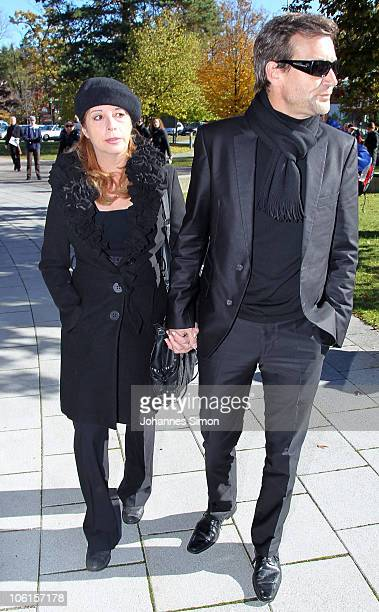 Actress Olivia Pascal and husband Peter Kanitz arrive for the funeral of Thomas Fuchsberger at August-Everding-Saal on October 27, 2010 in Gruenwald...