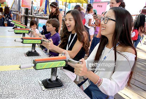 Actress Olivia Rodrigo and Madison Hu play a round at the Top Glow Booth during the 17th Annual Mattel Party on the Pier on September 25 2016 in...
