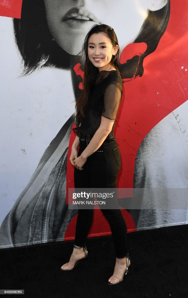 Actress Olivia Sui arrives for the premiere of Universal Pictures' 'Blumhouse's Truth or Dare' at the ArcLight Cinemas Dome in Hollywood, California on April 12, 2018. / AFP PHOTO / Mark Ralston