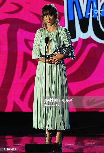 Actress Olivia Wilde accepts the Do Something Movie Star award onstage during the 2011 VH1 Do Something Awards at the Hollywood Palladium on August...