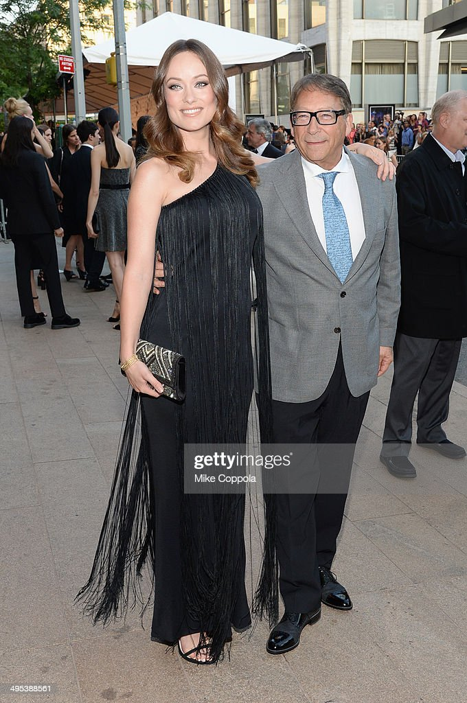 Actress Olivia Wilde (L) and designer Stuart Weitzman attend the 2014 CFDA fashion awards at Alice Tully Hall, Lincoln Center on June 2, 2014 in New York City.