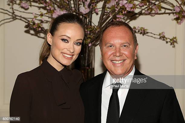 Actress Olivia Wilde and honoree designer Michael Kors pose for a photo at the World Food Program USA's Annual McGovernDole Leadership Award Ceremony...
