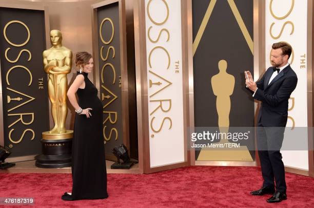 Actress Olivia Wilde and Jason Sudeikis attends the Oscars held at Hollywood Highland Center on March 2 2014 in Hollywood California