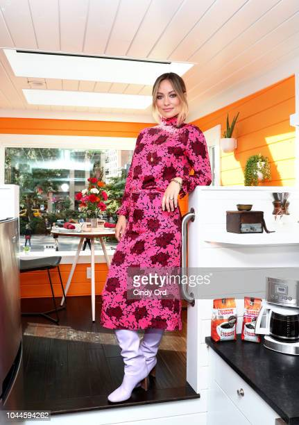 Actress Olivia Wilde helps bring the slogan America Runs On Dunkin to life at the Home That Runs On Dunkin powered by recycled coffee grounds on...