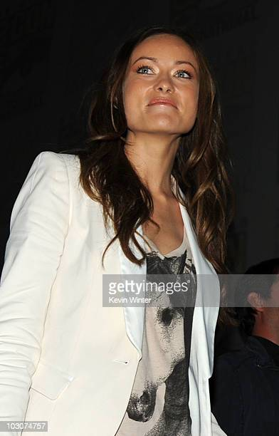 Actress Olivia Wilde walks onstage at the 'Cowboys Aliens' panel discussion during ComicCon 2010 at San Diego Convention Center on July 24 2010 in...