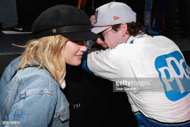 Actress Olivian Holt talks with Ryan Blaney driver of the PPG Ford during the Monster Energy NASCAR Cup Series Auto Club 400 at Auto Club Speedway on...