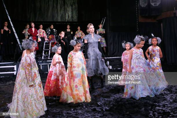 Actress Ophelia Kolb and Models children walk the runway in front of daughter of Charlelie Couture, Yamee Couture, singer Lio's twins Garance and Lea...