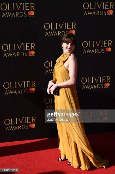 Actress Ophelia Lovibond poses on the red carpet upon arrival to attend the 2017 Laurence Olivier Awards in London on April 9 2017 / AFP PHOTO /...