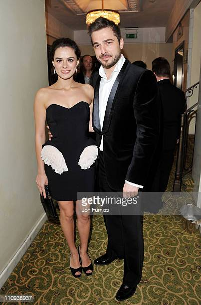 Actress Ozge Ozpirincci and actor Engin Altan Duzyatan attend The Jameson Empire Awards 2011 at The Grosvenor House Hotel on March 27 2011 in London...