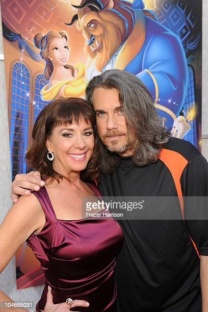 Actress Paige O'Hara and actor Robby Benson arrives at the 'Beauty and the Beast' SingALong DVD premiere at the El Capitan theater on October 2 2010...