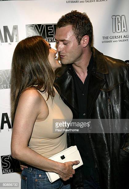 Actress Paige Turco kisses her husband Jason O'Mara as they attend a party at QUO sponsored by the Gersh Agency celebrating New York Upfronts with LA...