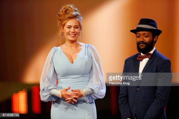 Actress Palina Rojinski and actor Eric Kabongo on stage during the award for Largest Audience for the film Willkommen bei den Hartmanns at the Lola...