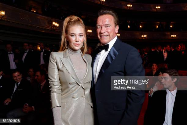 Actress Palina Rojinski and Arnold Schwarzenegger arrives for the GQ Men of the year Award 2017 at Komische Oper on November 9 2017 in Berlin Germany