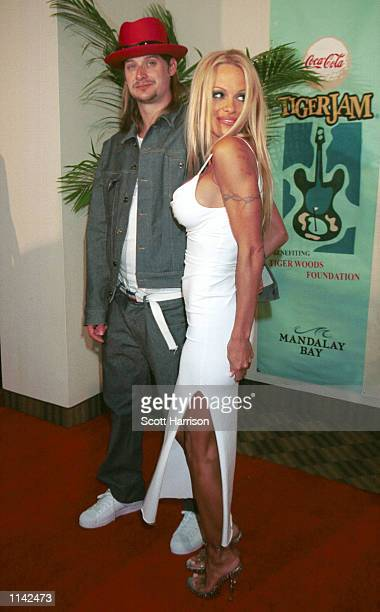 Actress Pam Anderson and musician Kid Rock pose for photos together April 28 2001 in Las Vegas NV