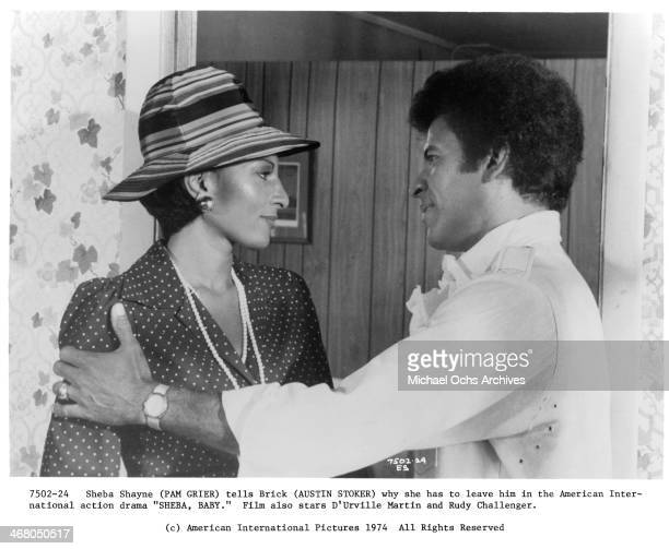 Actress Pam Grier and actor Austin Stoker on set of the movie 'Sheba Baby circa 1975