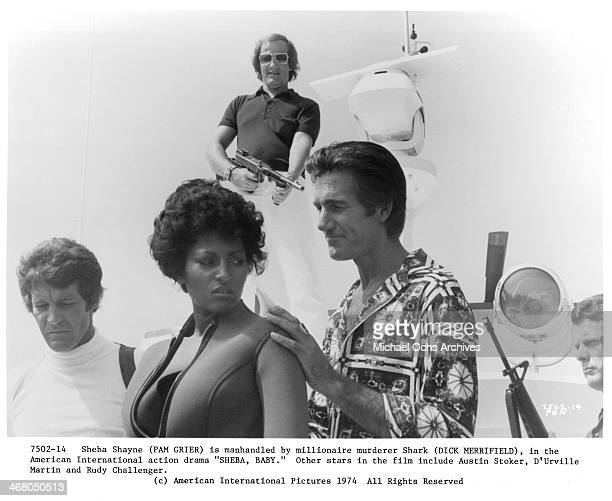 Actress Pam Grier and actor Dick Merrifield on set of the movie 'Sheba Baby circa 1975
