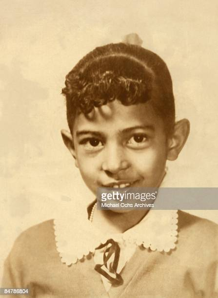 Actress Pam Grier at seven years old poses for a photo circa 1956
