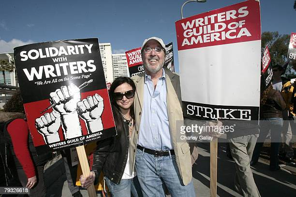 Actress Pamela Adlon and producer James L Brooks pose as members of the Screen Actors Guild join striking writers in a display of unity outside Fox...