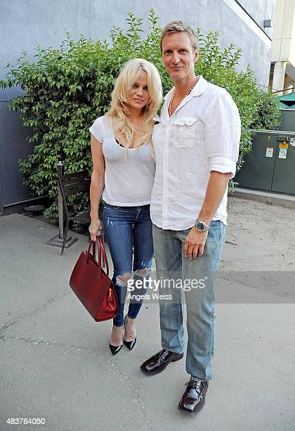 Actress Pamela Anderson and director Shaun Monson attend the screening of Unity at Universal CityWalk on August 12 2015 in Universal City California