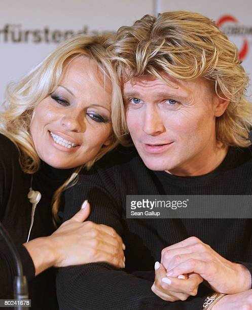 Actress Pamela Anderson and Dutch magician Hans Klok attend a press conference on March 14 2008 in Berlin Germany Anderson is in Berlin to star with...