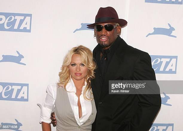 Actress Pamela Anderson and former NBA player Dennis Rodman arrive at PETA's 15th Anniversary Gala and Humanitarian Awards at Paramount Studios on...