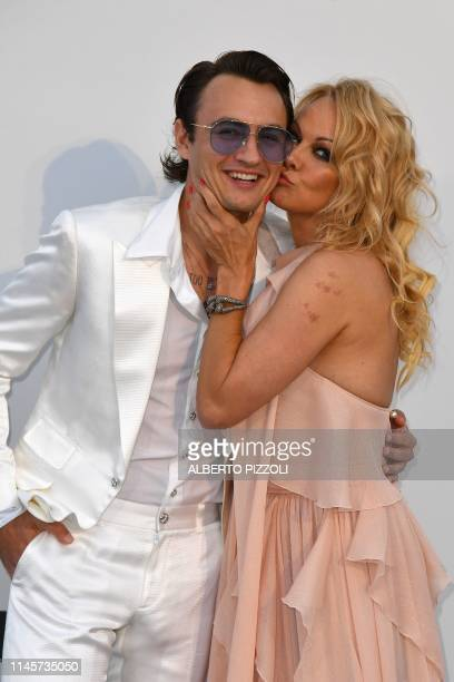 Actress Pamela Anderson and her son Brandon Thomas Lee pose as they arrive on May 23, 2019 for the amfAR 26th Annual Cinema Against AIDS gala at the...