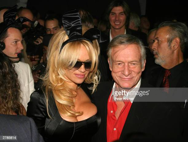 Actress Pamela Anderson and Hugh Hefner at the Playboy 50th Anniversary celebration December 4 2003 in New York City