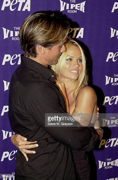 Supermodel marcus schenkenberg stock photos and pictures getty images actress pamela anderson and marcus schenkenberg pose for photographers at petas 20th anniversary party at thecheapjerseys Gallery