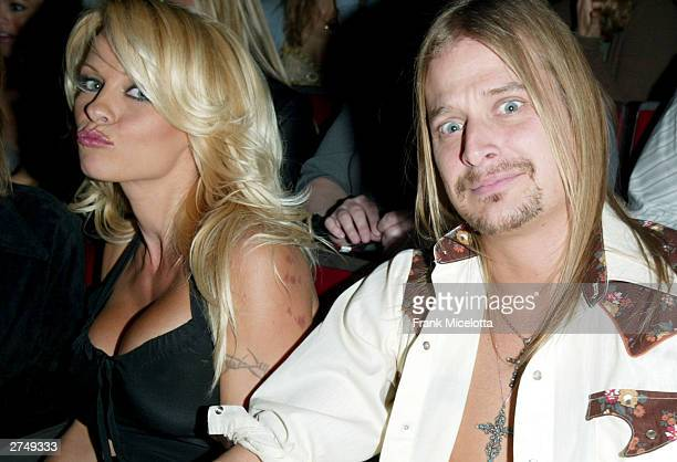 Actress Pamela Anderson and musician Kid Rock pose as they watch the show at VH1's Big In 2003 Awards on November 20 2003 at Universal City in Los...