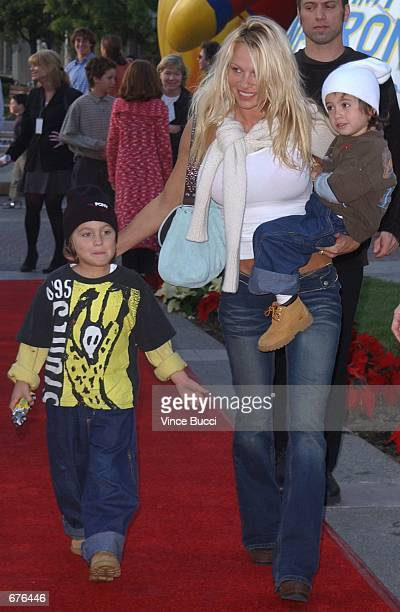 Actress Pamela Anderson and sons attend the premiere of the animated film 'Jimmy Neutron Boy Genius' December 9 2001 at Paramount Studios in...