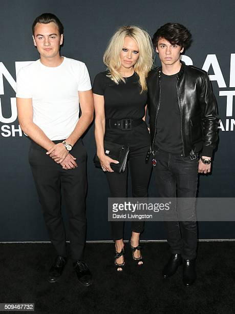 Actress Pamela Anderson and sons Brandon Lee and Dyland Lee attend Saint Laurent at Hollywood Palladium on February 10 2016 in Los Angeles California