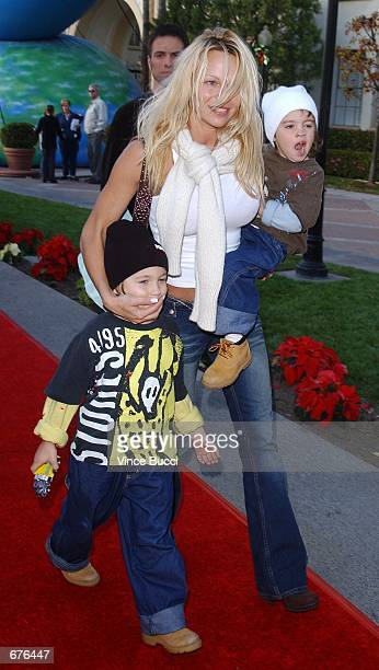 Actress Pamela Anderson and sons Dylan and Brandon attend the premiere of the animated film 'Jimmy Neutron Boy Genius' December 9 2001 at Paramount...