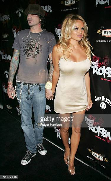 Actress Pamela Anderson and Tommy Lee arrive for the grand opening party of Rokbar Hollywood on June 302005 in Hollywood California