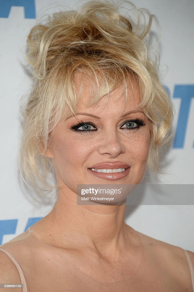 Actress Pamela Anderson attends the LA launch party for Prince's PETA Song at PETA on June 7, 2016 in Los Angeles, California.
