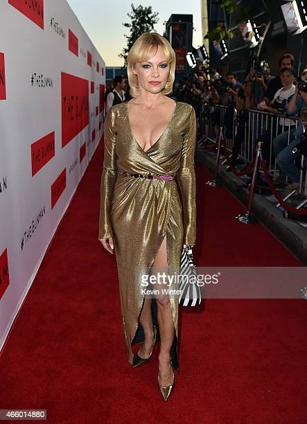 Actress Pamela Anderson attends the premiere of Open Road Films' The Gunman at Regal Cinemas LA Live on March 12 2015 in Los Angeles California