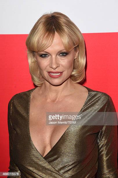 Actress Pamela Anderson attends the premiere of Open Road Films' 'The Gunman' at Regal Cinemas LA Live on March 12 2015 in Los Angeles California