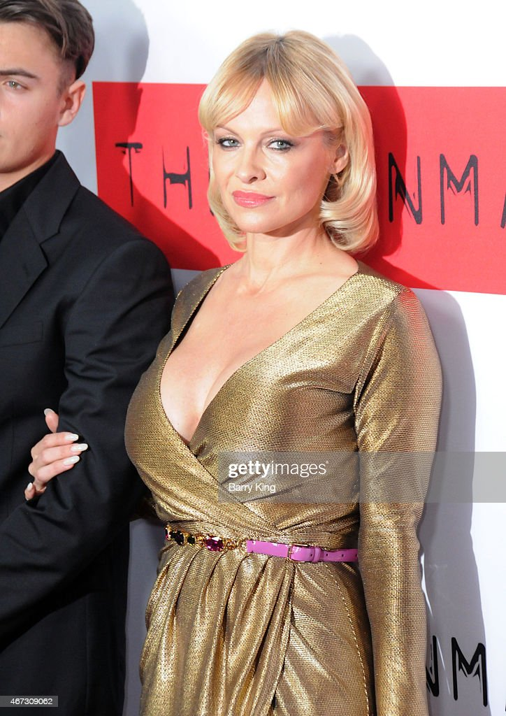 Actress Pamela Anderson attends the premiere of 'The Gunman' at Regal Cinemas L.A. Live on March 12, 2015 in Los Angeles, California.