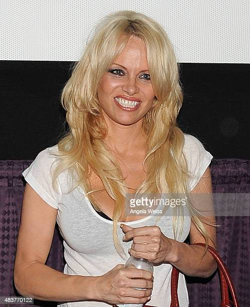Actress Pamela Anderson attends the screening of Unity directed by Shaun Monson at Universal CityWalk on August 12 2015 in Universal City California