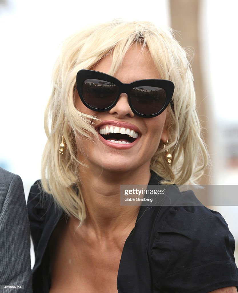 Actress Pamela Anderson attends the wedding of Dan Mathews and Jack Ryan at the Welcome to Fabulous Las Vegas sign on November 27, 2014 in Las Vegas, Nevada.