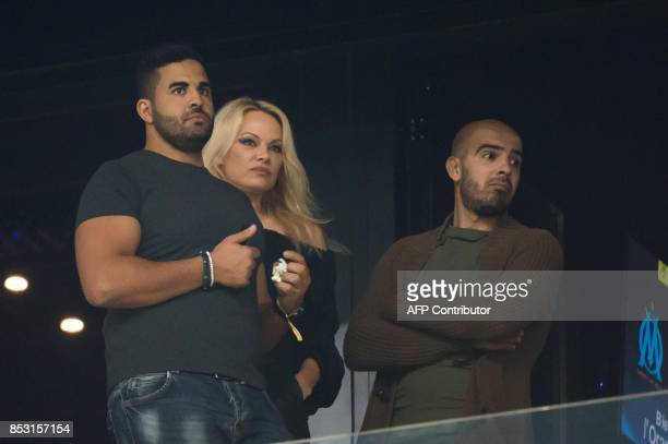 US actress Pamela Anderson is pictured prior to the French L1 football match Olympique de Marseille vs Toulouse on September 24 2017 at the Velodrome...