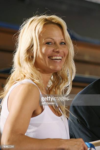 Actress Pamela Anderson laughs before the basketball game between the Loyola Marymount Lions and the Pepperdine Waves on January 26 2008 at Firestone...