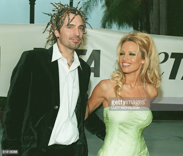 US actress Pamela Anderson Lee arrives at the People for the Ethical Treatment of Animals awards with her husband Tommy Lee 18 September 1999 in Los...