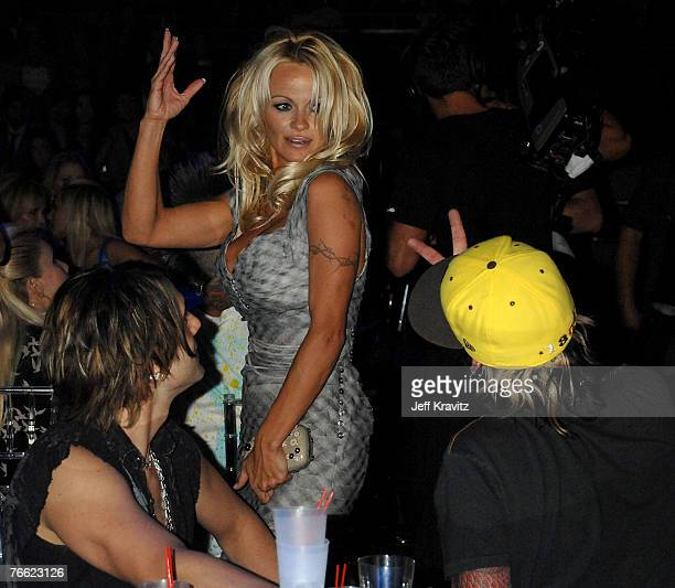 Actress Pamela Anderson Magician Criss Angel and Musician Tommy Lee attends the 2007 MTV Video Music Awards at the Palms Casino Resort on September 9...