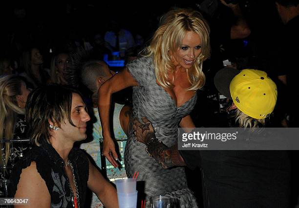 Actress Pamela Anderson Magician Criss Angel and Musician Tommy Lee attend the 2007 MTV Video Music Awards at the Palms Casino Resort on September 9...