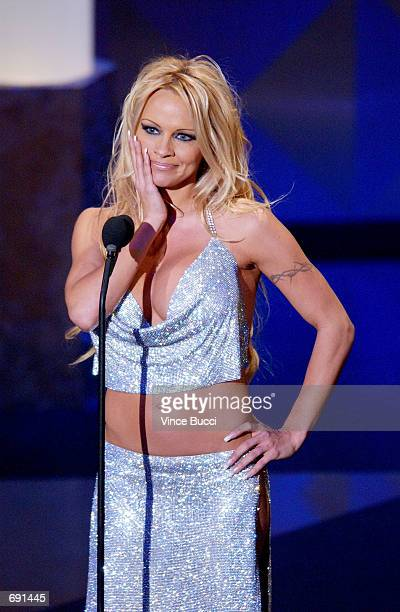 Actress Pamela Anderson makes a face on stage during the 29th Annual American Music Awards January 9 2002 in Los Angeles CA Anderson said in a...