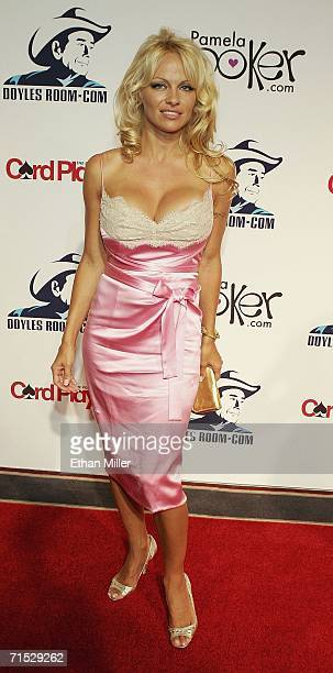 Actress Pamela Anderson poses on the red carpet at the Doyle Brunson poker player appreciation party at the Bellagio July 27 2006 in Las Vegas Nevada