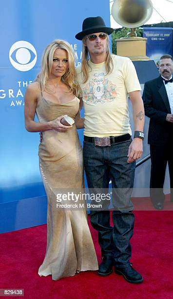 Actress Pamela Anderson poses with her boyfriend musician Kid Rock at the 44th Annual Grammy Awards at Staples Center February 27 2002 in Los Angeles...